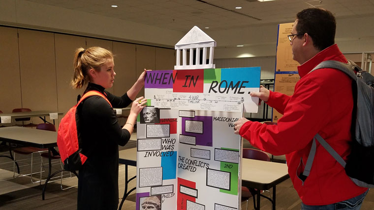 Teacher helps student set up NHD project